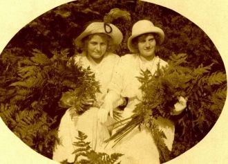 Two Women holding Ferns