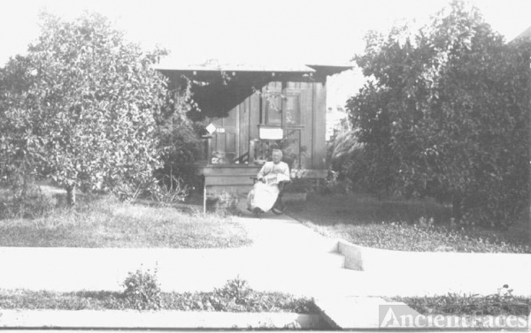 woman in front of home