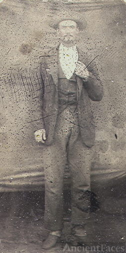 Tintype photo of man in hat
