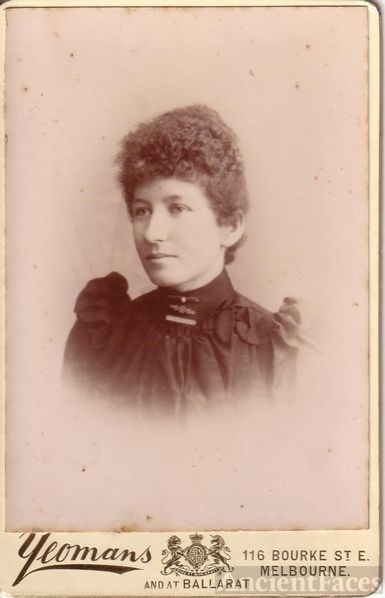 unknown woman with tight curls