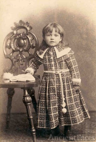 victorian girl in plaid dress