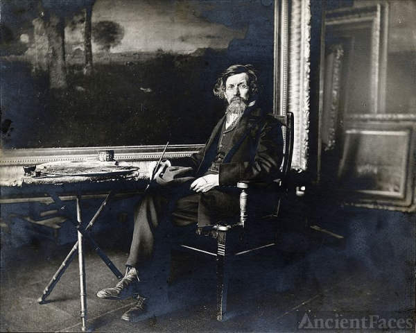 George Inness in studio