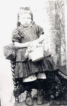 Small English girl (Lizzie) holding a basket