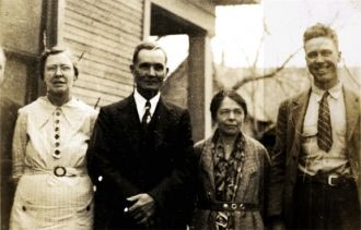 Joel and Myrtle Holcombe with son Chester and his wife Erah