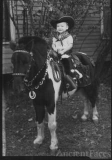 Child on photographer's pony