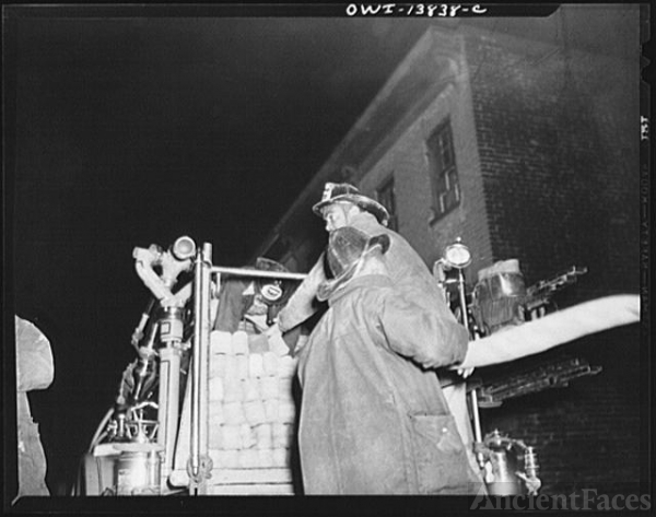 Firehouse Station No. 4. Washington, D.C. Firemen pull a...
