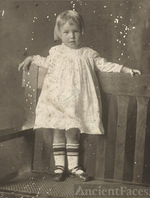 Unknown Child Standing on Bench