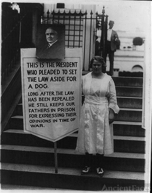 [Young women picketing outside White House gates for...