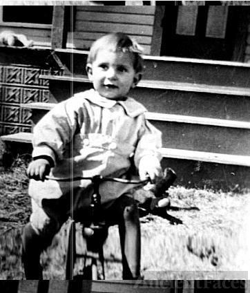 small boy on tricycle