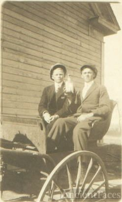 Two men on wagon with bottle