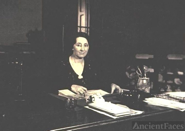 Verna Rogers Henry, at her desk
