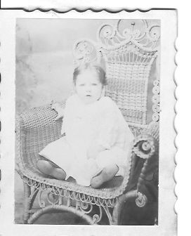 39 DME Baby in Whicker Chair