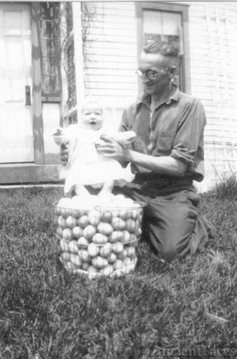 Uncle Cecil Murchie and Karen Hannigan on basket of eggs [Maine/NH]