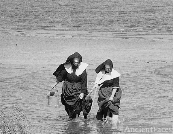 Nuns Clamming in Habits