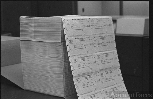 [Large stack of computer printouts, at a New York City...