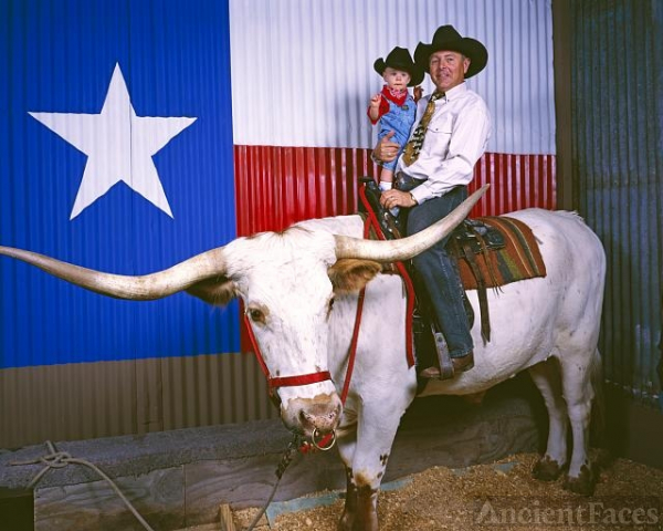 Cowboy and his grandson on a Longhorn at the Houston...