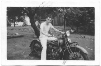 Eugene V Dabney on motorcycle