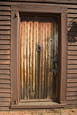 The front door, dating between 1690 and 1740, was purchased from legendary antiques dealer Roger Bacon. The door has several opposing layers joined by rosehead nails in a diamond pattern, highly sought by collectors.