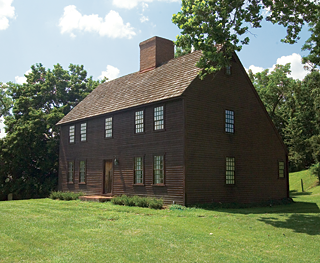 The Connecticut salt box faces south; at its back are the contours of the land. The chimney box, which leads to five fireplaces, is built with replica eighteenth-century bricks. The early period hardware and original architectural elements used throughout the house purchased from I.G. Wiese and Harold Cole of Woodbury, Connecticut.