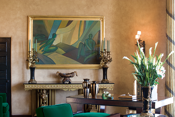 A painting by contemporary artist Jayme Odgers represents three of the seven chakras; a painting across the room represents the other four. The console table was designed by Zoltan Papp of Artisan Restoration, who paid tribute to both the Art Deco and Second Empire styles.