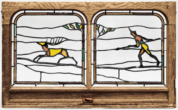 "Fig. 4a: Previously attributed to William Price (1861–1916). Leaded glass; white oak frame. H. 28-1/4, W. 46-3/8, D. 1-7/8 in. 1974-146-7. Purchased with the Thomas Skelton Harrison Fund, 1974. Courtesy, Philadelphia Museum of Art. This hunt window is one of a series of seven windows originally installed at ""Yorklynne,"" the John O. Gilmore house, Merion, Pa, 1899."