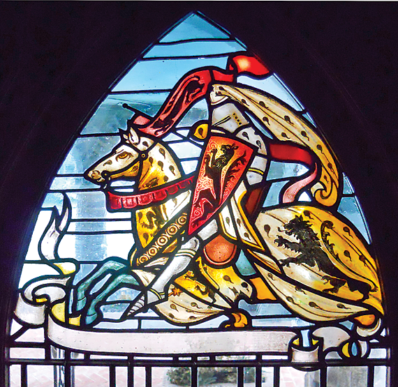 Fig. 5b: The stained-glass knight is one of a pair of windows that flanks the front door of Price's 1901 Louis Clarke House. Photography by the author.