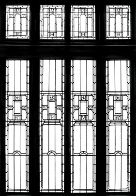 Fig. 7b: The hall window from the 1911 Wheeler house, Indianapolis, Indiana, seems to foretell art deco design, especially as D'Ascenzo first envisioned it on paper (7a). The small arches that march across the centers of the four long panels in the Wheeler window are idiosyncratic devices peculiar to Will and Walter Price and, as such, they may be a measure of the architect's involvement with the design process. 7a: Courtesy and photography, The Athenaeum of Philadelphia; 7b: Courtesy Marian University; photography by Benjamin L. Ross, LEED AP BD+C.