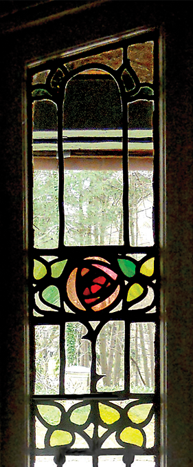 "Fig. 6a: The aesthetic of Nicola D'Ascenzo (1871–1954) is evident in two windows he made for the Rose Valley house Walter Price renovated with his wife during the first few years after their marriage in 1906. D'Ascenzo used floral motifs again in the later ""light screens"" he designed for William Price's 1911 Wheeler house (Figs. 7a–b). Today, the Rose Hedge windows seem to look back to British designs from the end of the nineteenth century. Photography by the author."