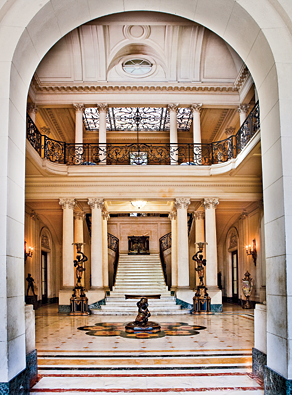 The double-height entrance hall of the palace of the countess of Revilla de Camargo leads to one of the most beautiful residential staircases in Cuba. Photography by Vanessa Rogers.