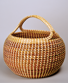 Fig. 10: Mary Jackson (b. 1945),  Cobra with Handle, ca. 1980.  Sweetgrass, bulrush, and palmetto, 15 x 16 inches.  Gibbes Museum, Charleston, S.C.,  Museum purchase with funds donated by Mr. Robert Marks (1984.026).