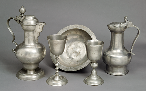 Fig. 4: Communion service of Augustus Lutheran Church. Large flagon attributed to Johann Philip Alberti (d. 1780), Philadelphia, ca. 1755. Small flagon, probably Cologne, Germany, ca. 1750.  Chalices, probably Germany, ca. 1750. Baptismal basin, probably England, ca. 1750. Courtesy, Augustus Lutheran Church, Trappe, Pa.