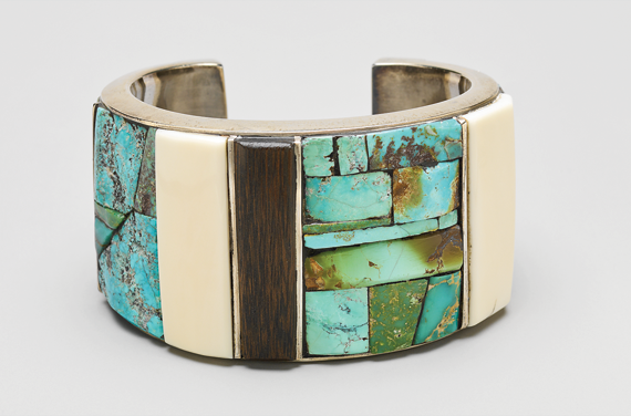 Fig. 6: Charles Loloma, Untitled, (Bracelet), 1968. Sterling silver, turquoise, ivory, ebony, and coral. 1 x 2-5/8 x 2 in. (3.8 x 6.7 x 5.1 cm). Museum of Arts and Design, Gift of the Johnson Wax Company, through the American Craft Council, 1977 (1977.2.55).