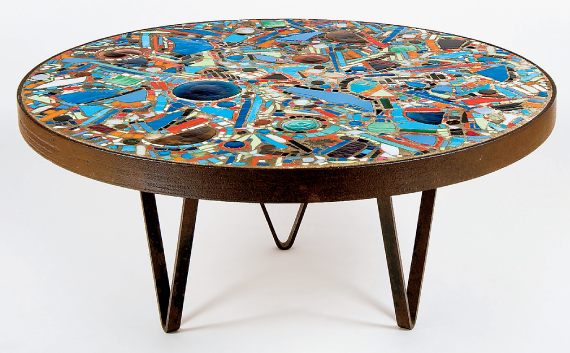 Fig. 1: Lee Krasner, Mosaic Table, 1947. Mixed media including broken glass, keys, coins, ceramic, pebbles, cement, iron wagonwheel, and steel. H. 21 (55.2 cm), diam. 46 in. (118.7 cm). Private collection, Courtesy, Michael Rosenfeld Gallery, New York, NY.