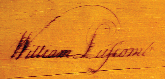"Detail of the proper right document drawer showing the calligraphic signature ""William Luscomb."""