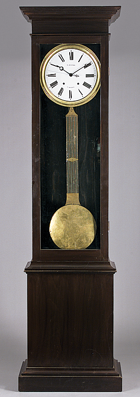 "Fig. 7: Stanislaus Fournier (born Saint-Aubin-le-Cauf, Normandy; d. March 25, 1883), tall case clock with round enamel dial marked ""S. Fournier Nle Orleans,"" mid-nineteenth century, in later stained pine case with stepped cornice. H. 92, W. 22, D. 11 in. Fournier apprenticed with the Paris firm of Lepaute who sent him to install a large clock in New Orleans' St. Louis Hotel in 1841 or 1842. Prompted by the lack of clock and watchmakers in the city, Fournier opened a shop on Toulouse Street and later at 50 Royal Street.  Photograph courtesy of Neal Auction Company, New Orleans."