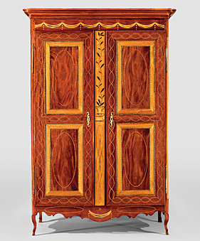 Figs. 14, 15: (Right) Louisiana Creole inlaid armoire, early nineteenth century. Mahogany, poplar, yellow pine, satinwood veneer, holly and maplewood stringing. H. 91, W. 61, D 23-1/8 in. Courtesy of the Colonial Williamsburg Foundation. Delicate pied de biche feet are a rare surviving feature on the cabriole legs. (Left) An inlaid armoire from the D. Benjamin Kleinpeter collection (shown open) bears a similar intertwined stringing inlaid across the frieze as in figure 14. Courtesy of The Historic New Orleans Collection. Photography by Jim Zietz.