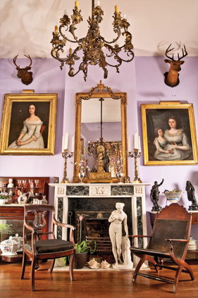 Fig. 6: Erard-Esby House, New Orleans, 1880. Interior with a lyre-back mahogany armchair (left), New York or Louisiana, ca. 1815,H. 35-3/4, D. 24, W. 22 in., discovered by Dr. George Crozat and inheritedby the Wolfords;similar to a New York side chair in the Kuntz collection, New Orleans Museum of Art, that was once part of the Archdiocesan collection. Eve Before the Fall(center)Carrara marble, H. 36, W. 12, D. 11 in., also from the Crozat collection. A rare cherry Campeche chair (right) with scalloped crest andpinecone finials, ca. 1820, possibly Louisiana, H. 36, W. 26, D. 28 in. Photography by Richard Sexton.