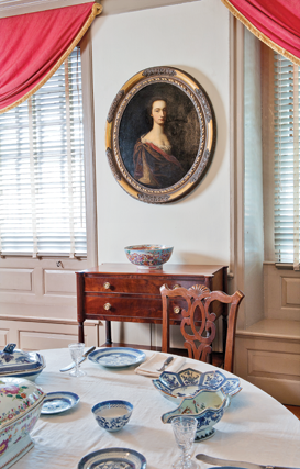 Fig. 3: View of Van Cortlandt Manor dining room showing Portrait of a Woman, probably Gertrude Van Cortlandt Beekman (1688–1777), att. to Evert Duyckinck III (1677–1727), New York, ca. 1726. Oil on canvas, 37-3/4 x 33 inches. Photography by Bryan Haeffele. Gift of Mrs. Helen C. Gillespie. (VC.2007.1).