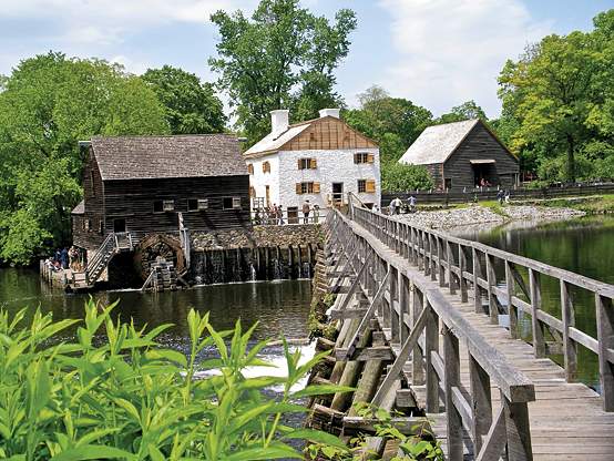 Fig. 2: The primary buildings at Philipsburg Manor include, from left, a mill, manor house, and barn. Photography by Bryan Haeffele.
