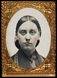 "Unidentified photographer Portrait of Ruby Devol, ca. 1860 ""Little Gem"" hand-tinted ferrotype in embossed brass mount Inscribed on the reverse side: ""Ruby""; 1 x 3/4 inches Courtesy, a Massachusetts Collector"