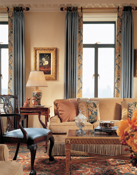 Cullman's comfortable conversational groupings in the living room, paired with couture details like embroidered cuffs on the drapes, create the perfect setting for Martin Johnson Heade's Cherokee Roses in a Vase.