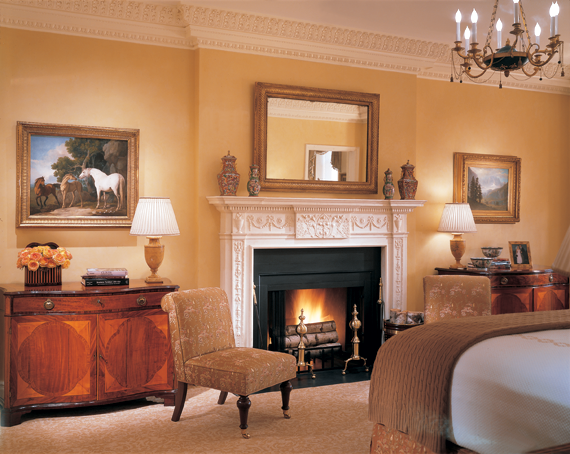 The focal point of the master bedroom is a nineteenth-century English George III-style white marble fireplace mantel. A pair of  Scottish George III mahogany serpentine commodes, circa 1785, flank it and serve as visual pedestals for George Stubbs' 1771 A Mare and a Foal with a Bay Horse, left, and on right, Albert Bierstadt's (1830–1902) circa-1872 Inyo California.