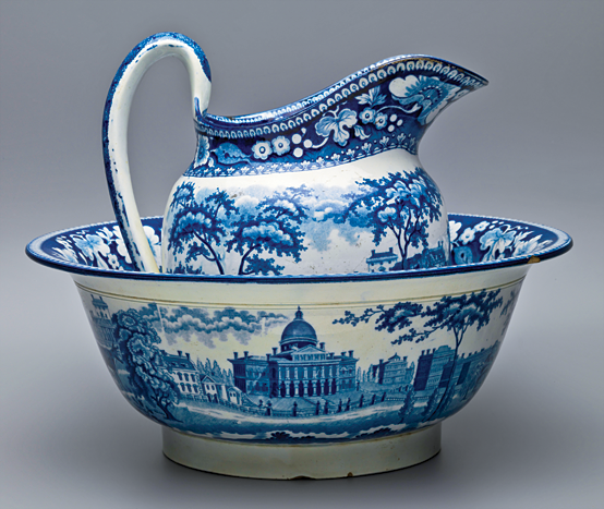 Fig. 7: Pitcher and bowl, attributed to John Rogers & Son, Staffordshire, ca. 1820. Earthenware. Pitcher: H. 8-3/4, W. 8-1/2 in.; bowl: H. 4-3/4, D. 12-1/4 in. Blue printed design depicting the Boston State House. This bowl and pitcher set came to Historic New England from the daughter of the original owner in 1929. Photograph by Adam Osgood. Courtesy, Historic New England, Gift of Mrs. Louisa J. Byington (1929.72.1, .2).
