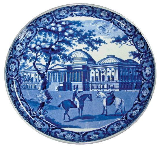 Fig. 6: Cheese stand by John and William Ridgway, Staffordshire, ca. 1827–1830. Earthenware. Diam. 12 in. Blue printed design depicting the Capitol Building, Washington. On reverse: blue printed lozenge-shaped mark inscribed with the title of the series, Beauties of America; the title of plate, Capitol, Washington; and the name of the maker. Private collection. Courtesy, Transferware Collectors Club.