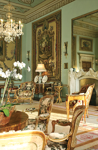 Fig. 2: The tapestry drawing room, 1776–1777, designed by James Wyatt around the set of Gobelins tapestries given to the third Duke of Richmond by King Louis XV of France. The chimneypiece was carved by John Bacon.