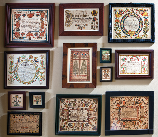 The Pennsylvania fraktur are arranged for maximum visual effect. Among the couple's favorites is the presentation fraktur by Johannes Setzer (n.d.), Hamilton Township, Northampton County, Pennsylvania, dated 1820 (center). The precision with which the trees are rendered results in a mirror image.