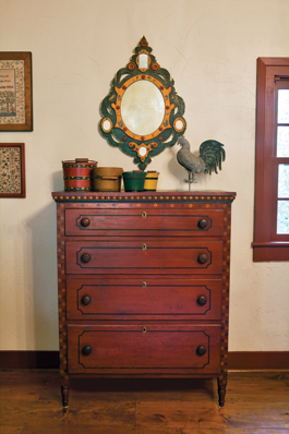This is the second Mahantongo Valley chest in the collection and was in Winterthur Museum when author Henry Reed included it in his book Decorated Furniture of the Mahantongo Valley (1987). The color schemes of the folk art mirror, J. Howard & Company rooster weathervane, Shaker berry buckets, and Lehnware water bucket complement the chest and create an appealing visual image. Olde Hope Antiques sold both Mahantongo chests to the couple, as well as the weathervane and buckets; the mirror is from Jim and Nancy Glazer.