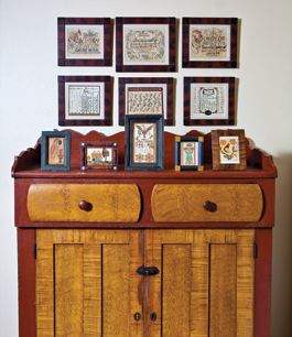 The splashboard of the circa-1840 Southern Lancaster County, Pennsylvania, cupboard, with original red and yellow grained finish, provides a decorative backdrop for a group of small watercolors from Southeastern Pennsylvania, dating from circa 1800 to the 1830s. The motifs on these colorful images include tulips and birds. One image relays the early Christian story of the pelican piercing its breast to feed its young; a similar example is illustrated in American Folk (2001). A portion of the twenty-three Vorschrift in the couple's collection hang on the wall above the cupboard.