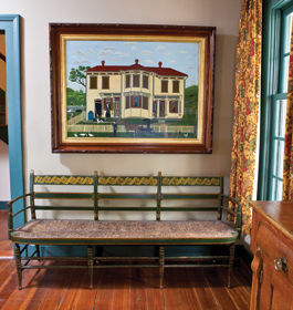 The couple was drawn to the primitive imagery of this circa-1880 house portrait, which dealer David Wheatcroft found for them in Ohio. The fancy settee, probably from New York, retains its original paint and rush seat.