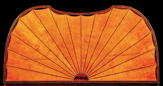 Fig. 6: Detail of the rayed top on the card table illustrated in fig. 1. Note how McGuffin used dark stringing to separate each ray, and placed a dark arc at the wide end of each ray. He also used the same rosewood crossbanding around the edge of the top of the sewing table seen in fig. 4. Photography by Gavin Ashworth.